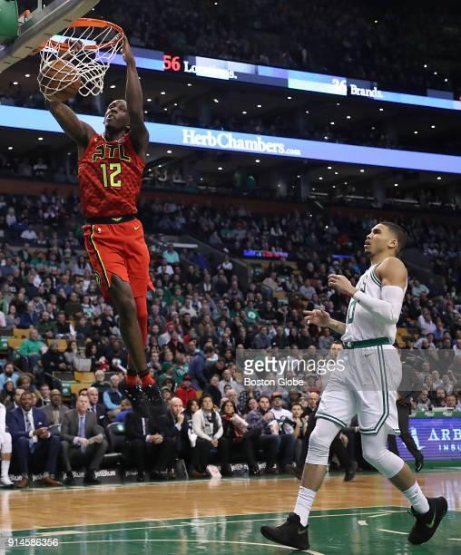 Atlanta Hawks Taurean Prince slam dunks beating Boston Celtics Jayson Tatum during first quarter action at TD Garden in Boston on Feb 2 2018