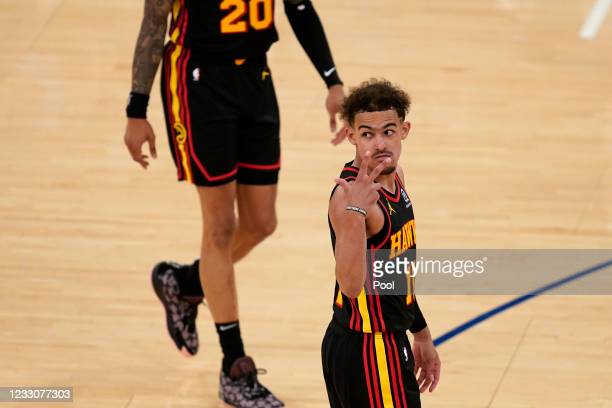 Atlanta Hawks' Trae Young gestures during the second half of Game 1 of an NBA basketball first-round playoff series against the New York Knicks on...