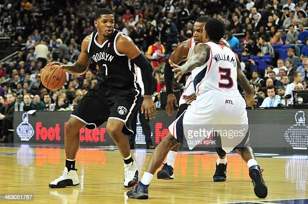 Atlanta Hawks' US player Louis Williams tries to block Brooklyn Nets' US player Joe Johnson during the NBA Global Games London 2014 basketball match...