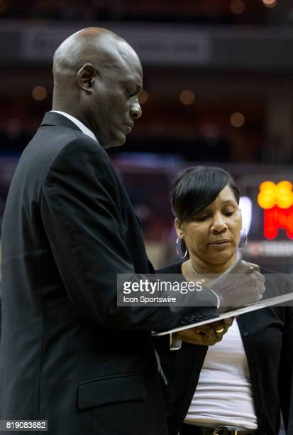 Atlanta head coach Micheal Cooper and assistant head coach Karleen Thompson sketch out a play during a WNBA game between the Washington Mystics and...