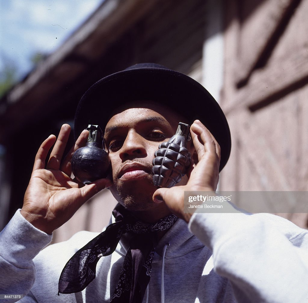 Atlanta hiphop artist MF 911 holds two vintage hand grenades to his face in a portrait taken for his record album, Georgia, 1990.