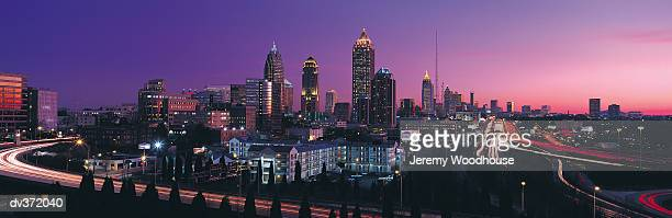atlanta in evening - atlanta skyline stock pictures, royalty-free photos & images