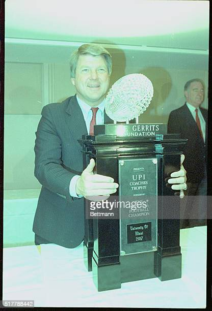 Jimmy Johnson still basking in the glory of Miami's national championship is awarded the UPI national championship trophy at the American Football...