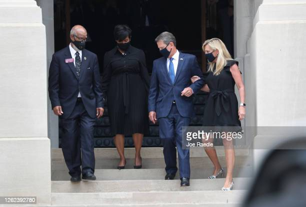 Atlanta Mayor Keisha Bottoms Georgia Governor Brian P Kemp and First Lady Marty Kemp arrive to watch as members of the joint services military honor...