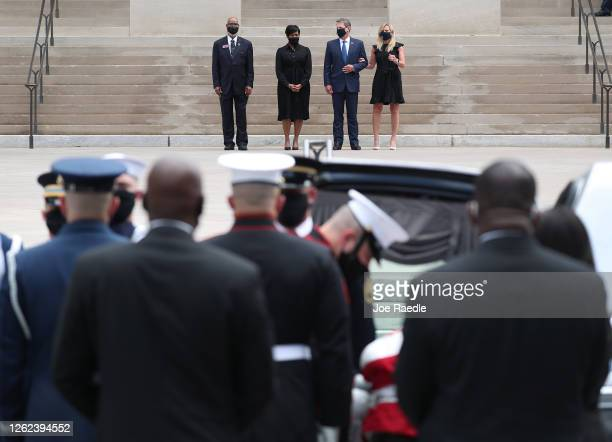 Atlanta Mayor Keisha Bottoms Georgia Governor Brian P Kemp and First Lady Marty Kemp watch as members of the joint services military honor guard...