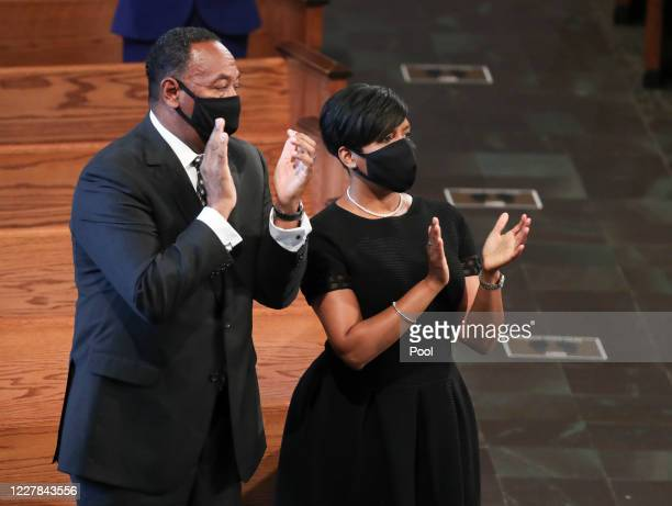 Atlanta Mayor Keisha Lance Bottoms and her husband Derek attend the funeral service of the late Rep John Lewis at Ebenezer Baptist Church on July 30...