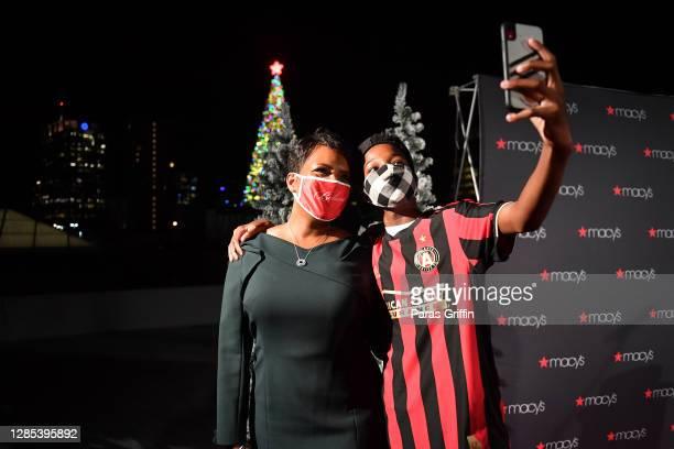 Atlanta Mayor Keisha Lance Bottoms and her son Langston Bottoms attend the 2020 Macy's Atlanta Great Tree Lighting Ceremony at Macy's Lenox Square on...