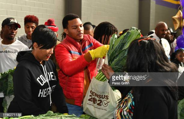 Atlanta Mayor Keisha Lance Bottoms and Messiah Harris attend T.I.'s 14th Annual Thanksgiving Turkey Giveaway For Atlanta Seniors In Need at C.T....