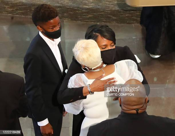 Atlanta Mayor Keisha Lance Bottoms consoles Tomika Miller the wife of Rayshard Brooks at the conclusion of his funeral in Ebenezer Baptist Church on...