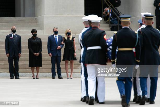 Atlanta Mayor Keisha Lance Bottoms Georgia Governor Brian Kemp and First Lady Marty Kemp watch as joint special services honor guard carry the casket...