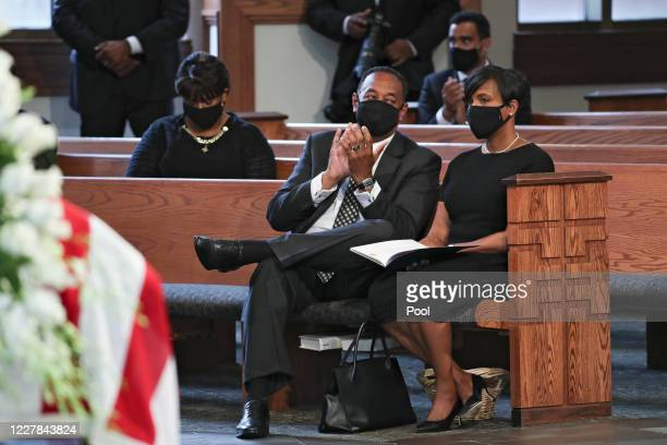 Atlanta Mayor Keisha Lance Bottoms sits with her husband Derek W Bottoms during the funeral service of the late Rep John Lewis at Ebenezer Baptist...