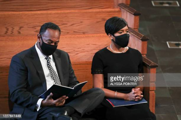Atlanta mayor Keisha Lance Bottoms with her husband Derek attend the funeral of late Civil Rights leader John Lewis at the State Capitol in Atlanta...
