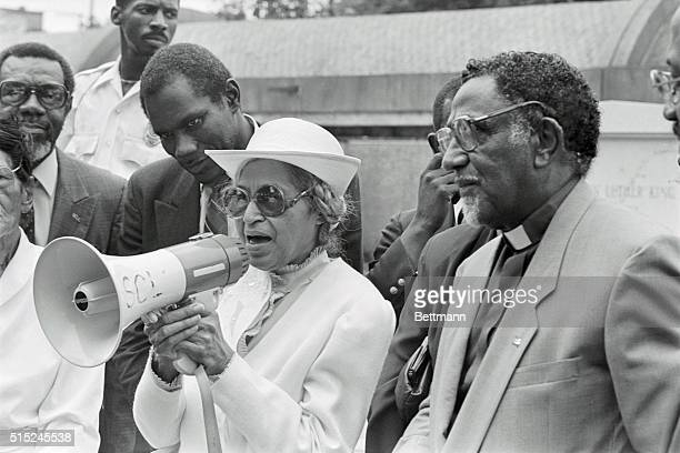 Mrs Rosa Parks center 76 year old civil rights pioneer who sparked the Montgomery Alabama bus boycott uses a bull horn to speak to the crowd who...