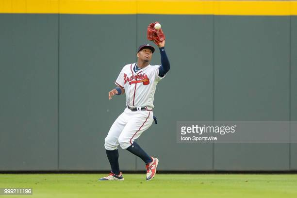 Atlanta outfielder Ronald Acuna Jr catches a fly ball during the game between Atlanta and Arizona on July 14th 2018 at SunTrust Park in Atlanta GA...