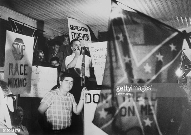 Atlanta segregationist JB Stoner addresses a crowd holding Confederate flags in St Augustine in Florida on a night of white supremacy rallying in 1964