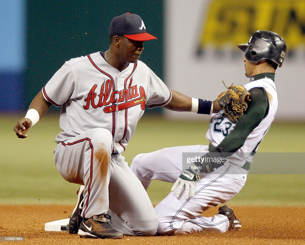 Atlanta shortstop Edgar Renteria applies the tag to Tampa Bay's Julio Lugo during Friday night's action at Tropicana Field in St. Petersburg, Florida on June 23, 2006.