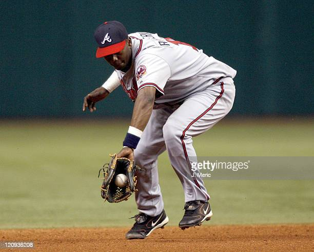 Atlanta shortstop Edgar Renteria backhands this play during Friday night's action against Tampa Bay at Tropicana Field in St Petersburg Florida on...