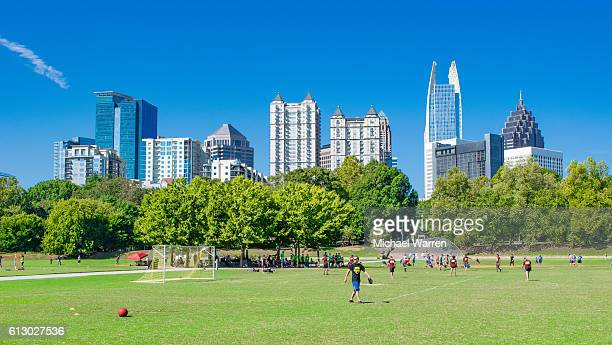 atlanta skyline and piedmont park - atlanta skyline stock pictures, royalty-free photos & images