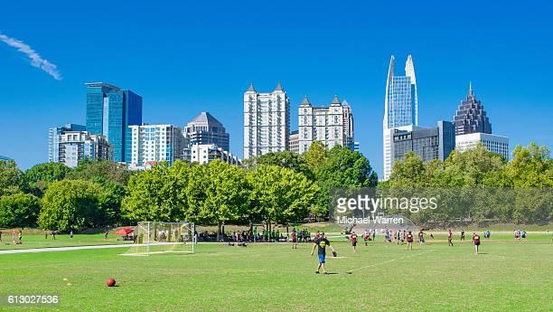 atlanta skyline and piedmont park - kickball stock photos and pictures
