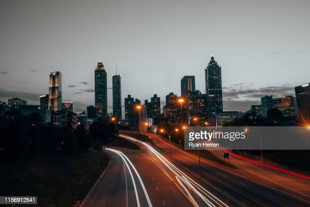 atlanta skyline at sunset - atlanta skyline stock pictures, royalty-free photos & images