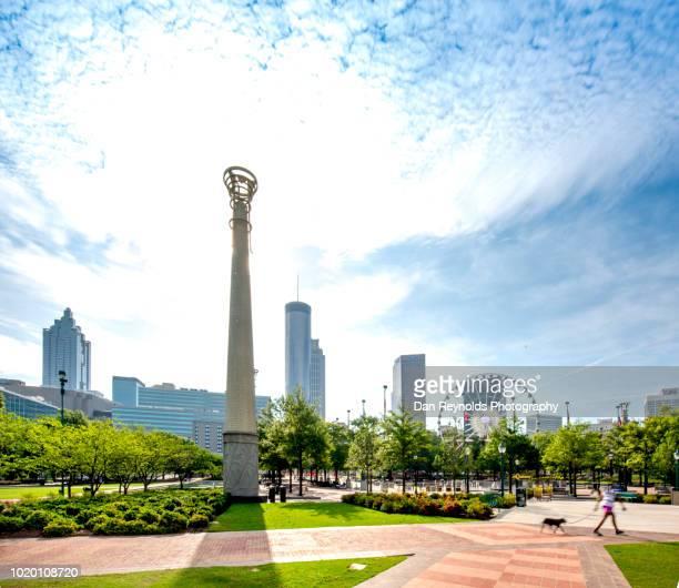 atlanta skyline - centennial park - atlanta stock photos and pictures