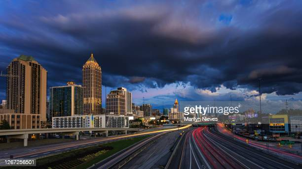 atlanta skyline during rush hour and a stormy night - atlanta georgia stock pictures, royalty-free photos & images