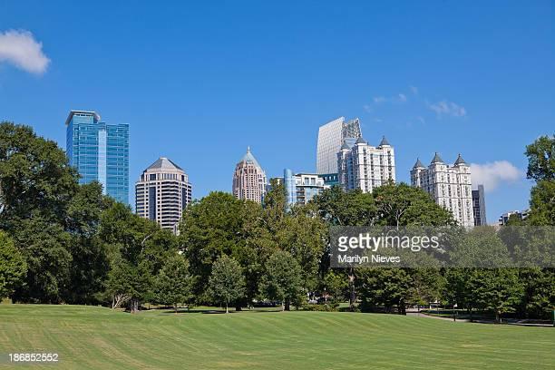 atlanta skyline from the park - piedmont park atlanta georgia stock pictures, royalty-free photos & images