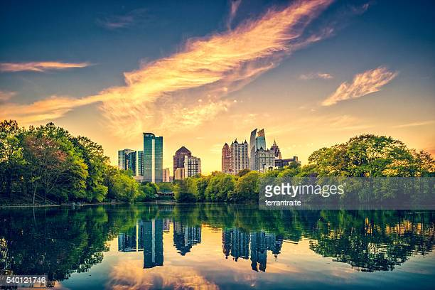 atlanta skyline - sunset lake stock photos and pictures