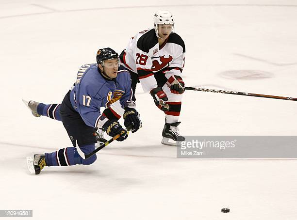 Atlanta Thrashers forward Ilya Kovalchuk and New Jersey Devils defenseman Brian Rafalski chase the puck during the game at the Philips Arena in...