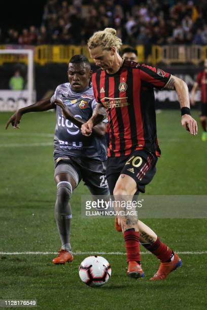 Atlanta United defender Brek Shea is pursued by Herediano midfielder Luis Diaz in the second half of the CONCACAF Champions League playoff football...