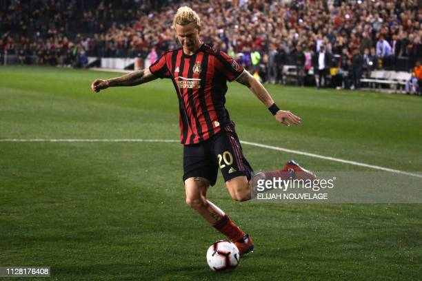 Atlanta United defender Brek Shea shoots on the Herediano goal in the first half of the CONCACAF Champions League playoff football match between...