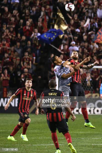 Atlanta United defender Leandro Gonzalez Pirez jumps up for a header with Herediano's Oscar Granados during the CONCACAF Champions League playoff...