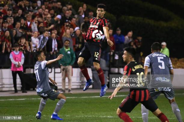 Atlanta United defender Miles Robinson jumps for the ball in the second half of the CONCACAF Champions League playoff football match between Atlanta...