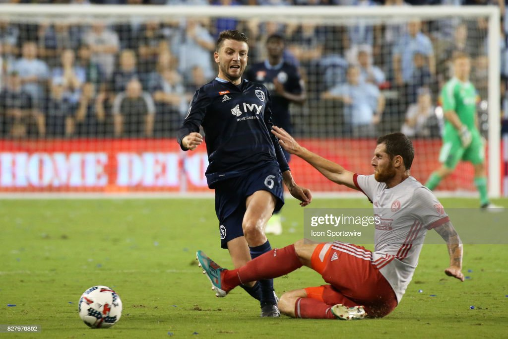 Atlanta United defender Miles Robinson (6) makes the tackle against Sporting Kansas City midfielder Ilie Sanchez (6) in the second half of an MLS match between Atlanta United and Sporting KC on August 6th, 2017 at Children's Mercy Park in Kansas City, KS. The match ended in a 1-1 draw.