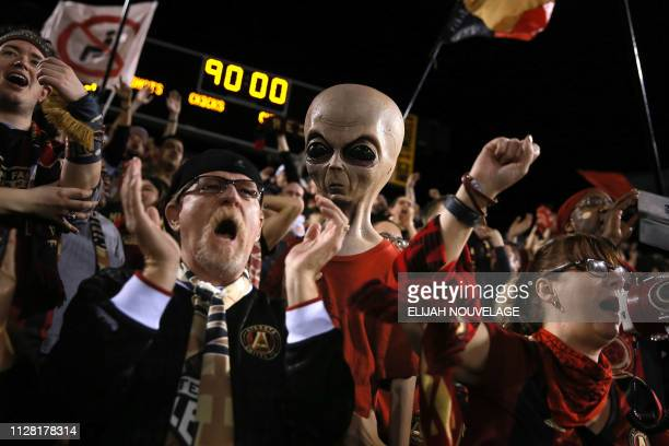 Atlanta United fans cheer at the end of the CONCACAF Champions League playoff football match between Atlanta United and Herediano at the Fifth Third...