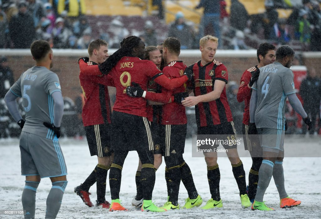Atlanta United FC celebrate a goal by Jacob Peterson #29 of Atlanta United FC as Francisco Calvo #5 and Jermaine Taylor #4 of Minnesota United FC look on during the second half of the match on March 12, 2017 at TCF Bank Stadium in Minneapolis, Minnesota. Atlanta defeated Minnesota 6-1.