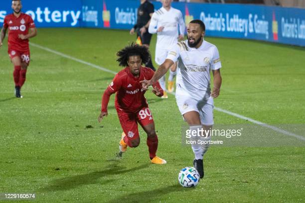 Atlanta United FC Defender Anton Walkes dribbles the ball with Toronto FC Forward Jayden Nelson in pursuit during the second half of a Major League...