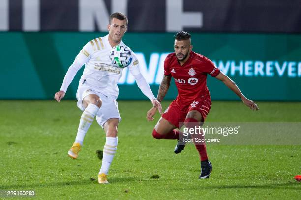 Atlanta United FC Defender Brooks Lennon and Toronto FC Defender Auro Jr compete for the ball during the second half of a Major League Soccer match...