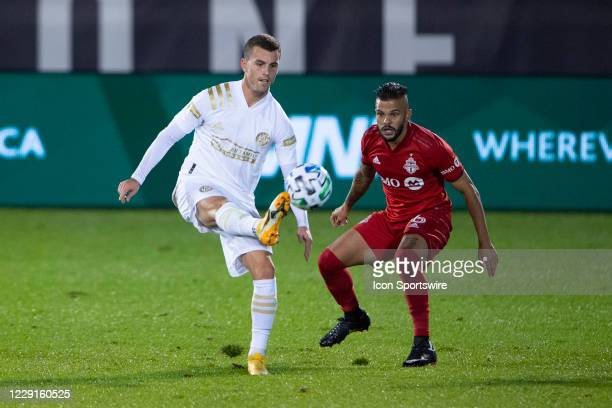 Atlanta United FC Defender Brooks Lennon gains control of the ball with Toronto FC Defender Auro Jr defending during the second half of a Major...