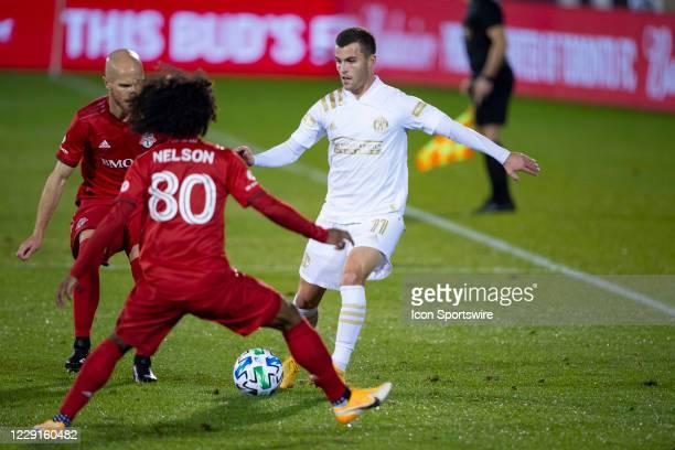 Atlanta United FC Defender Brooks Lennon passes the ball inbetween Toronto FC Midfielder Michael Bradley and Toronto FC Forward Jayden Nelson during...