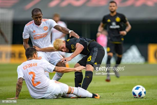 Atlanta United FC defender Franco Escobar and Atlanta United FC midfielder Darlington Nagbe battle with Columbus Crew SC midfielder Cristian Martinez...