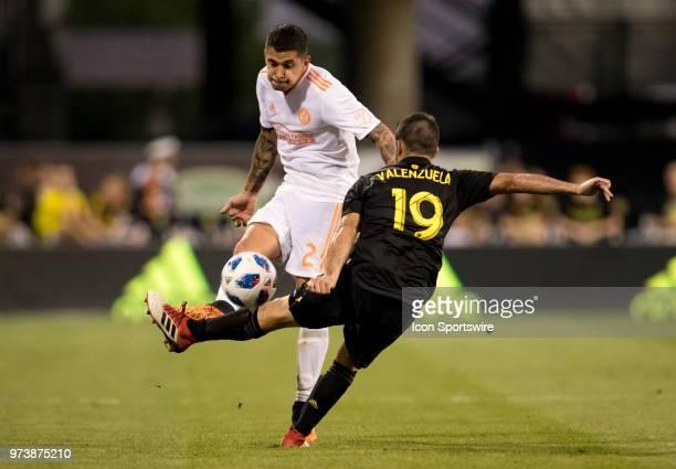 Atlanta United FC defender Franco Escobar just gets the ball over Columbus Crew SC defender Milton Valenzuela in the MLS regular season game between...