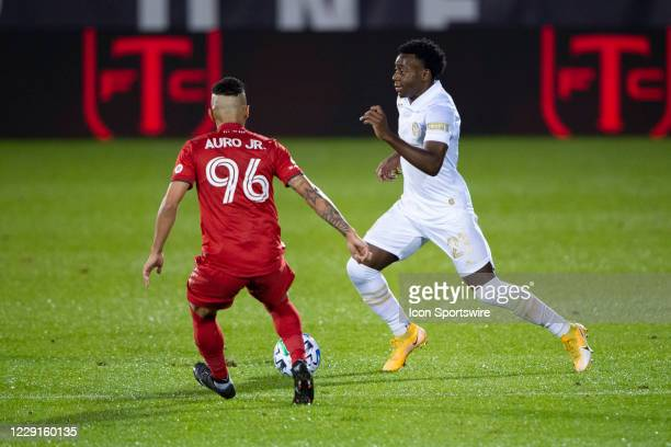 Atlanta United FC Defender George Bello dribbles the ball with Toronto FC Defender Auro Jr during the first half of a Major League Soccer match...