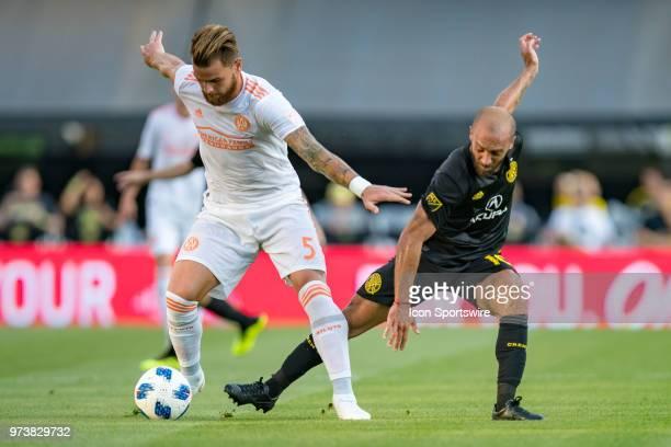 Atlanta United FC defender Leandro Gonzalez Pirez and Columbus Crew SC midfielder Federico Higuain battle in the MLS regular season game between the...
