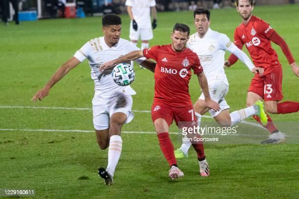 Atlanta United FC Defender Miles Robinson and Toronto FC Midfielder / Forward Pablo Piatti chase the ball during the second half of a Major League...