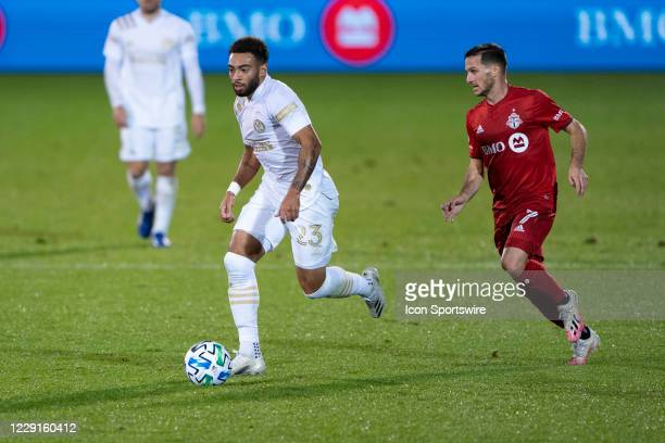 Atlanta United FC Forward Jake Mulraney dribbles the ball up the field with Toronto FC Midfielder / Forward Pablo Piatti in pursuit during the first...