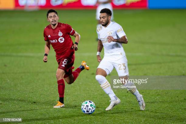 Atlanta United FC Forward Jake Mulraney dribbles the ball with Toronto FC Midfielder Mark Delgado in pursuit during the first half of a Major League...
