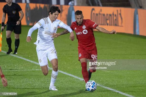 Atlanta United FC Midfielder Jurgen Damm and Toronto FC Defender Auro Jr battle for the ball during the second half of a Major League Soccer match...