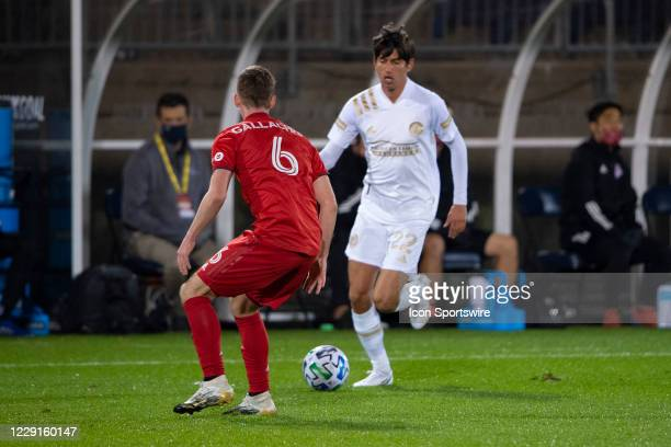 Atlanta United FC Midfielder Jurgen Damm dribbles the ball with Toronto FC Defender Tony Gallacher defending during the first half of a Major League...