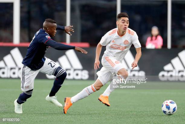 Atlanta United FC midfielder Miguel Almiron escapes from New England Revolution midfielder Luis Caicedo during a match between the New England...